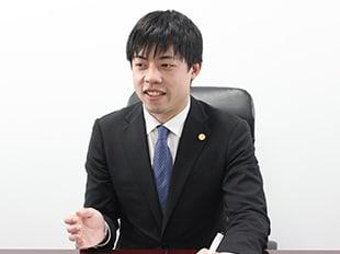 町田支店長・第二東京弁護士会、栄田国良の写真