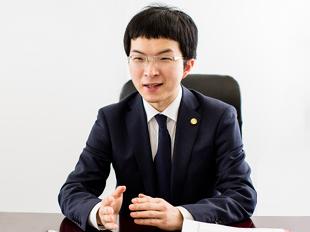 越谷支店長・埼玉弁護士会、足立博之の写真