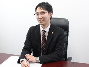 市川本八幡支店長・千葉県弁護士会、野村和史の写真