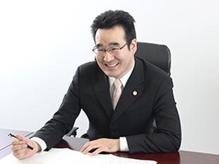 平塚支店長・神奈川県弁護士会、稲垣孝宣の写真